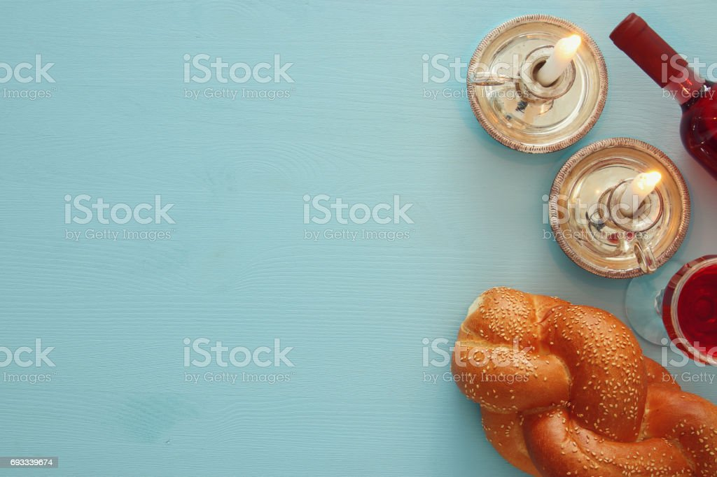 shabbat image. challah bread, wine and candles. Top view stock photo