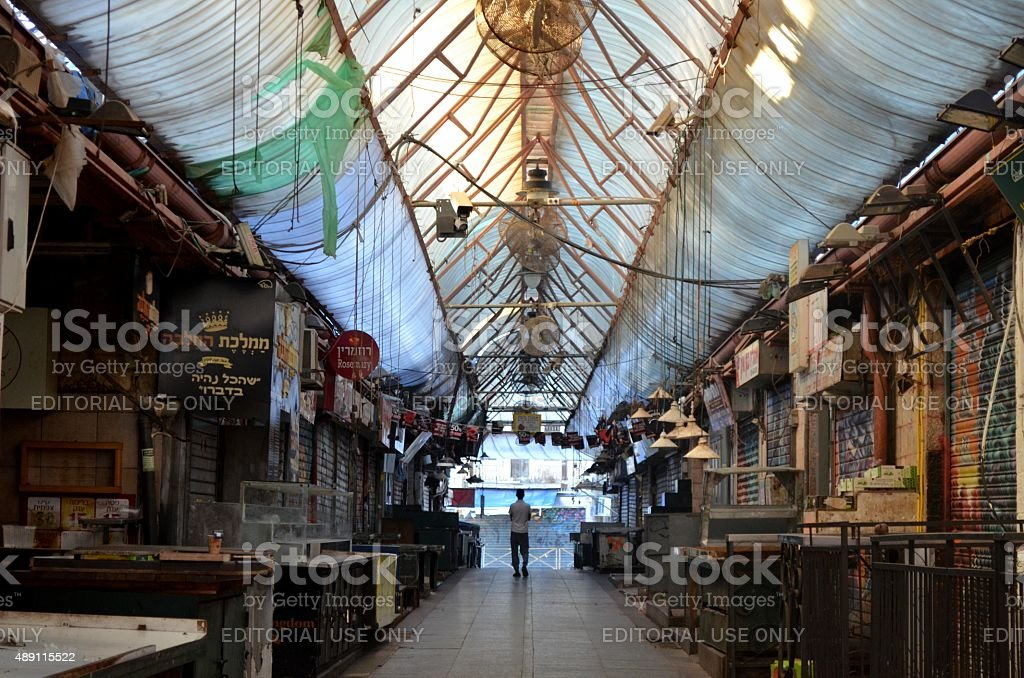 Shabbat in Jerusalem: Man at the empty Mahane Jehuda Market stock photo