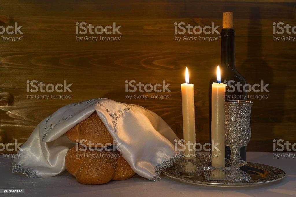 Shabbat Shalom - wine, challah and candles stock photo