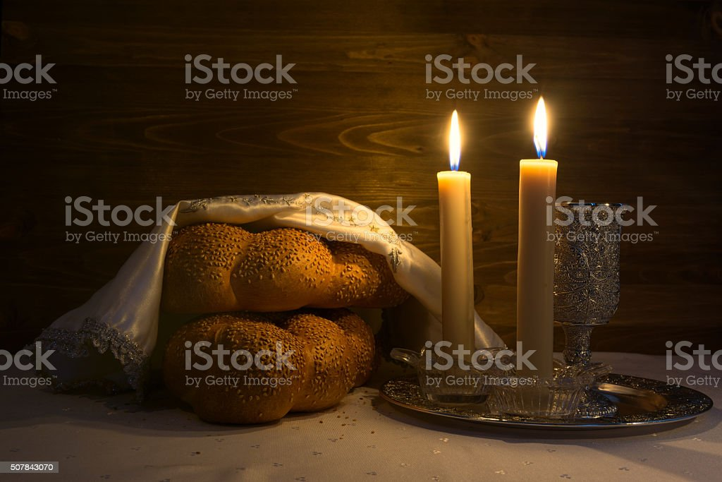 Shabbat Shalom - wine, challah and candles stock photo