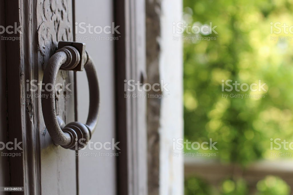 Shabby chic door with a knocker stock photo