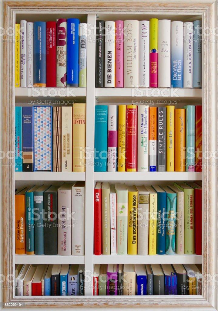 Shabby chic wooden frame on book shelves