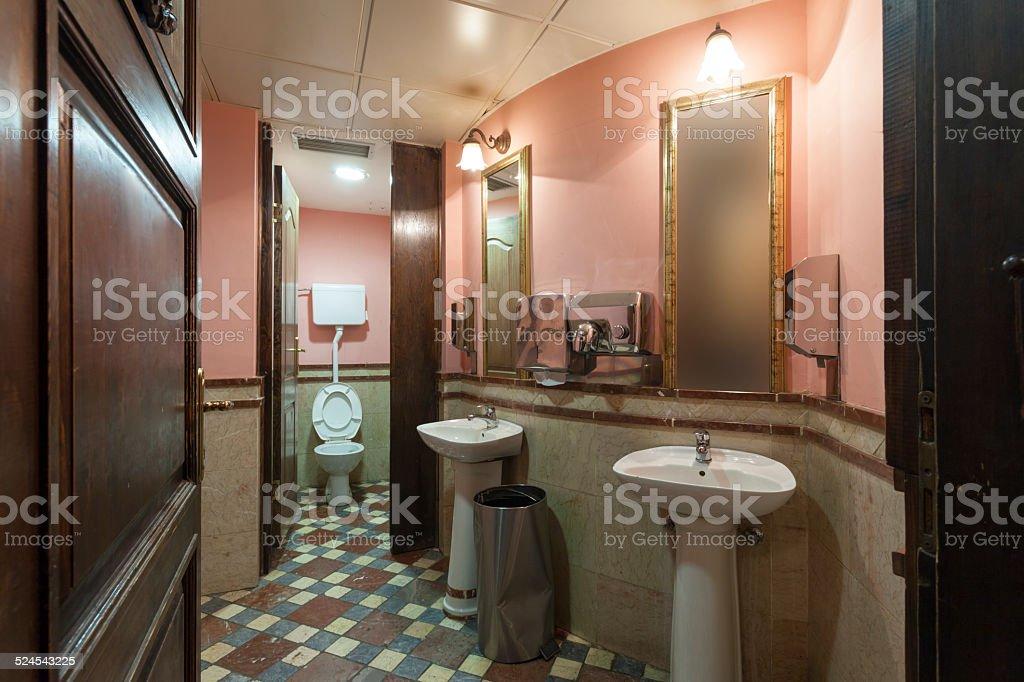 Shabby restroom interior stock photo