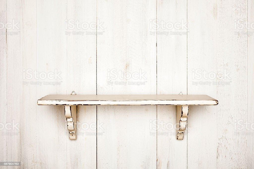 Shabby shelf on white painted wood background stock photo