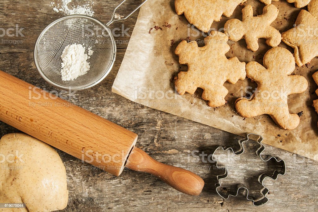 shabby table dough, cookies Christmas figures top view stock photo