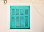 shabby turquoise shutters