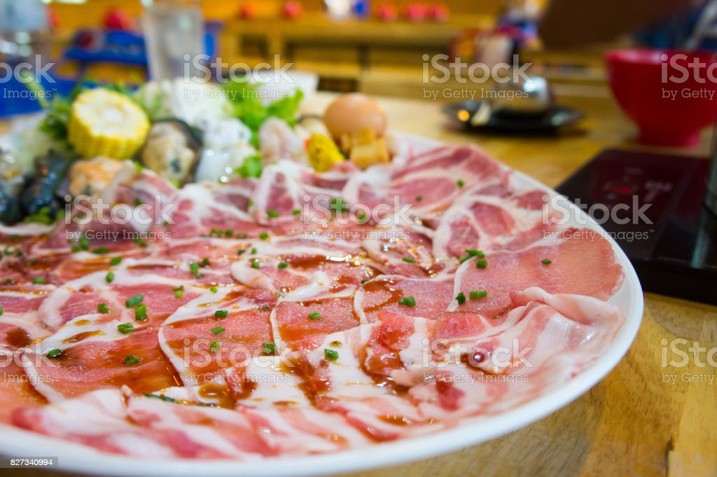 Shabu pork meat slides , Shabu style cooking in restaurant stock photo
