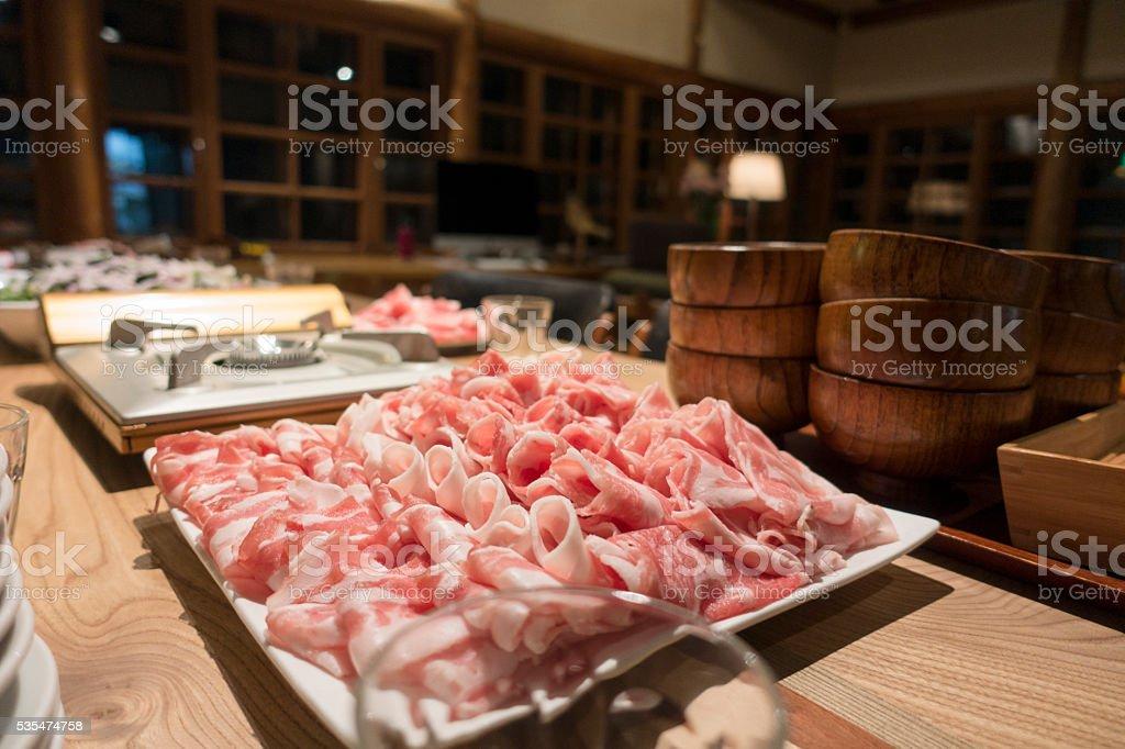 Shabu Shabu Chinese Hotpot Dinner Ingredients on Table stock photo