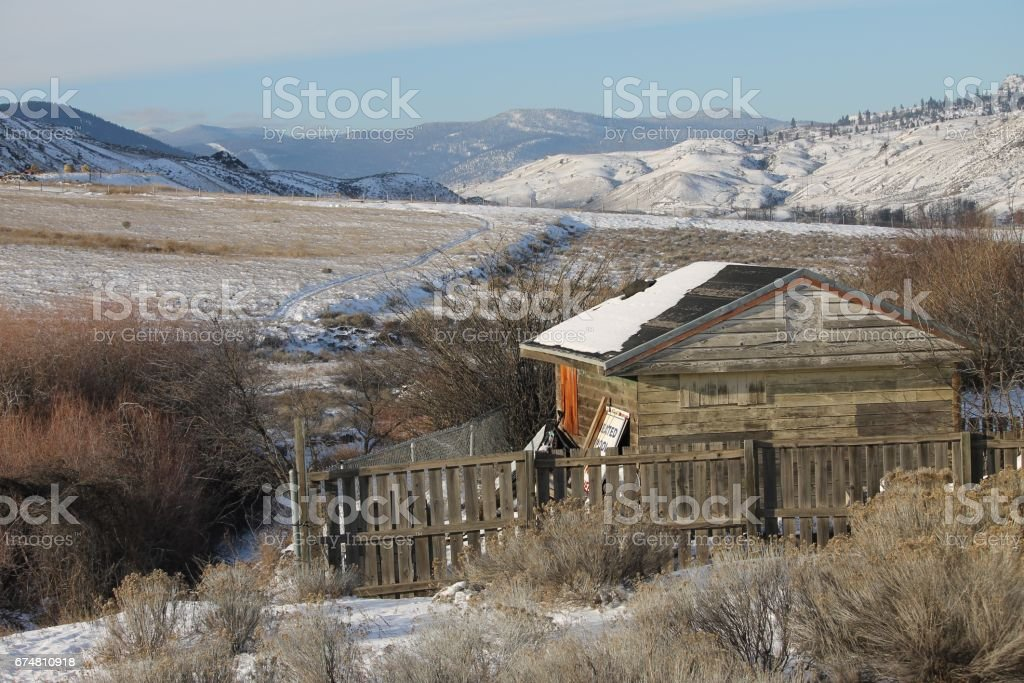Shack by the creek in the winter stock photo