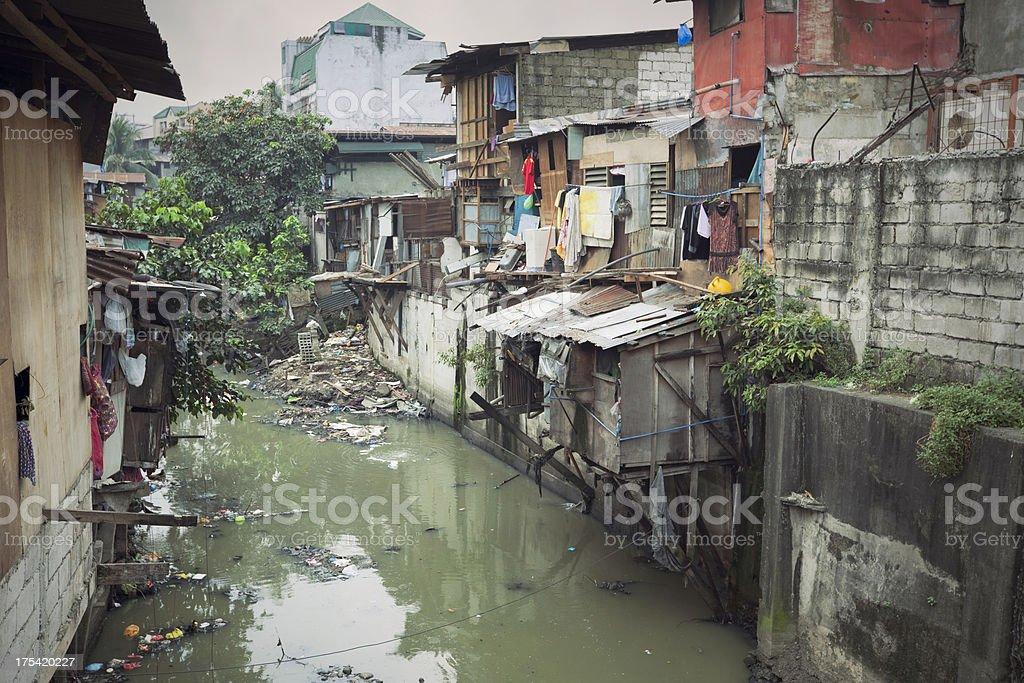 Shacks along the water in Manila, Philippines stock photo