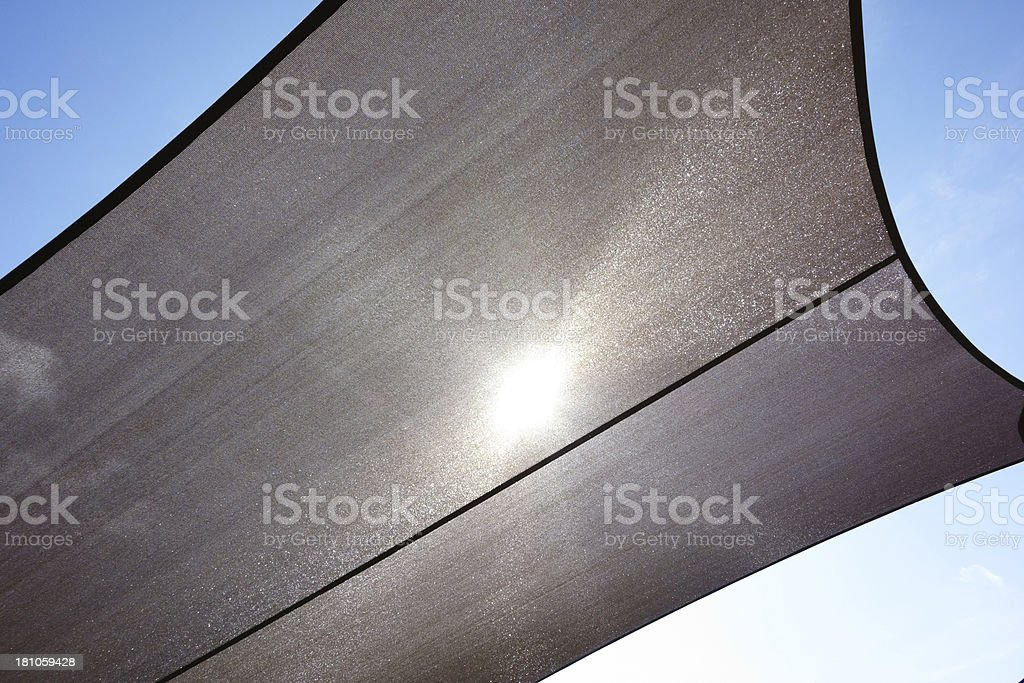 Shade canopy blocking strong direct sunlight royalty-free stock photo
