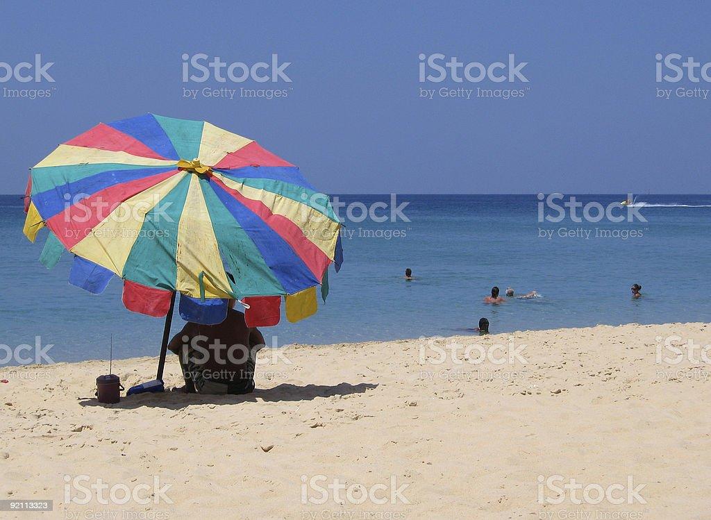 Shade of an umbrella royalty-free stock photo