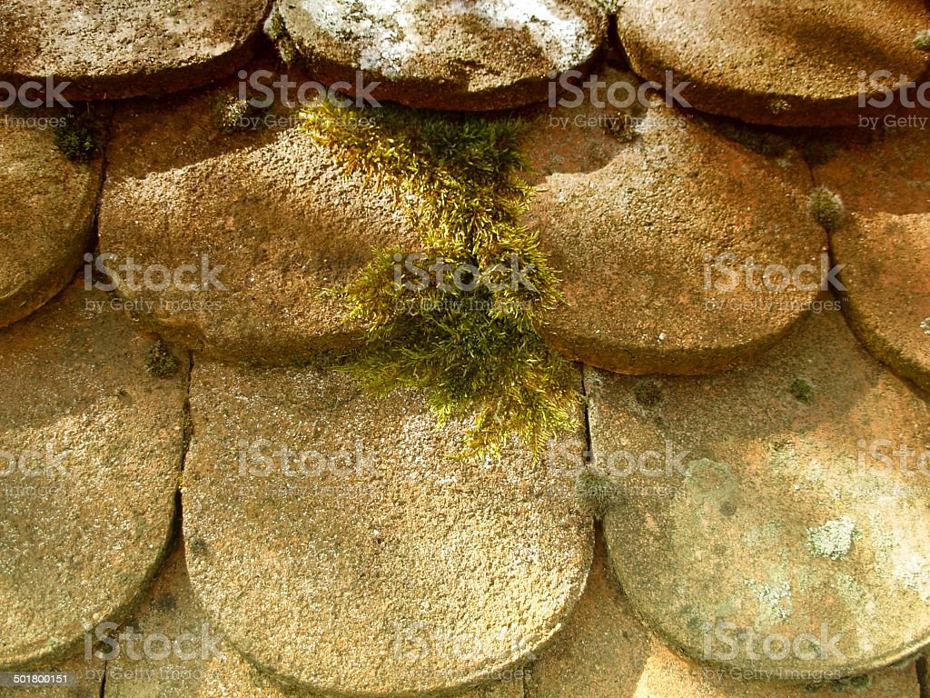 Shaded roof of ancient potsherd y stock photo