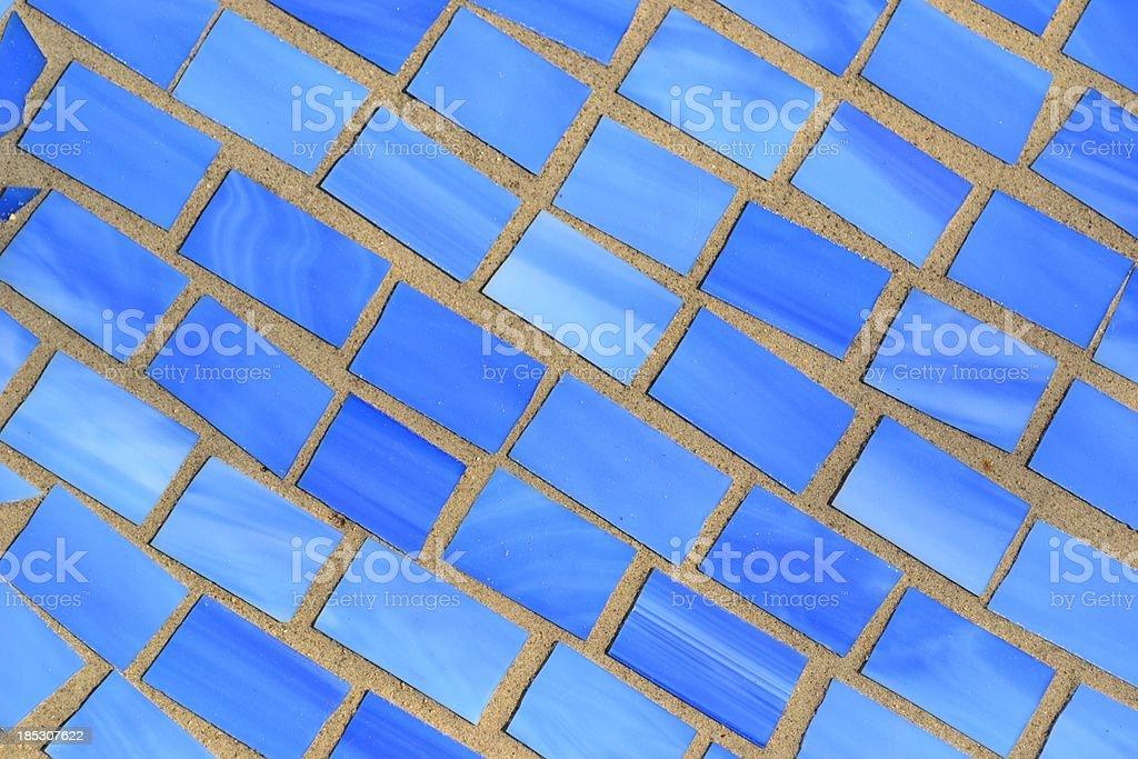 Shades Blue Irregular Glass Tiles in Brick Morter stock photo