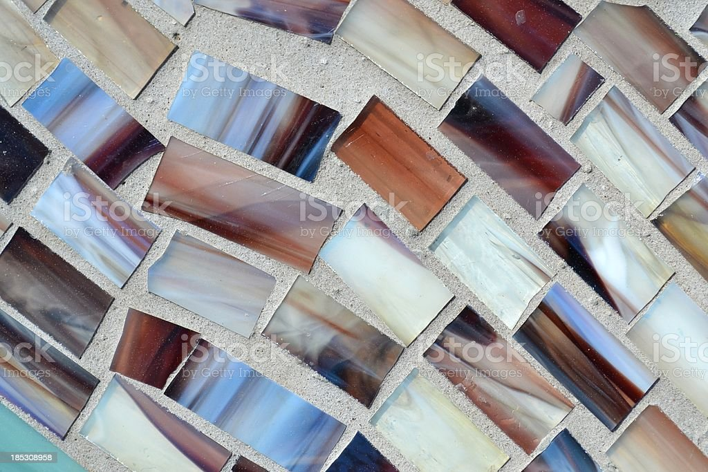 Shades Brown Irregular Glass Tiles in Brick Morter stock photo
