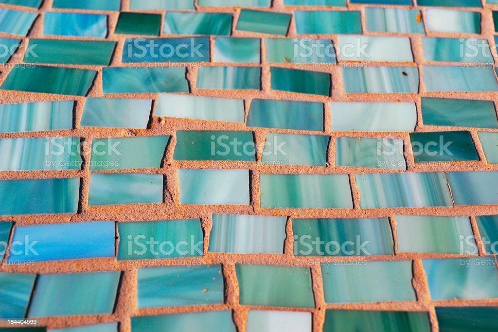 Shades Green Blue Teal Irregular Glass Tiles in Brick Morter stock photo