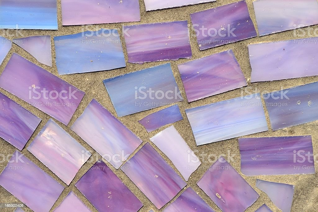 Shades Purple and Blue Irregular Glass Tiles in Brick Morter stock photo