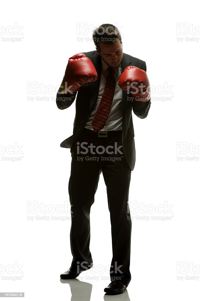 Shadow Boxing Businessman in suit with red boxing gloves. royalty-free stock photo