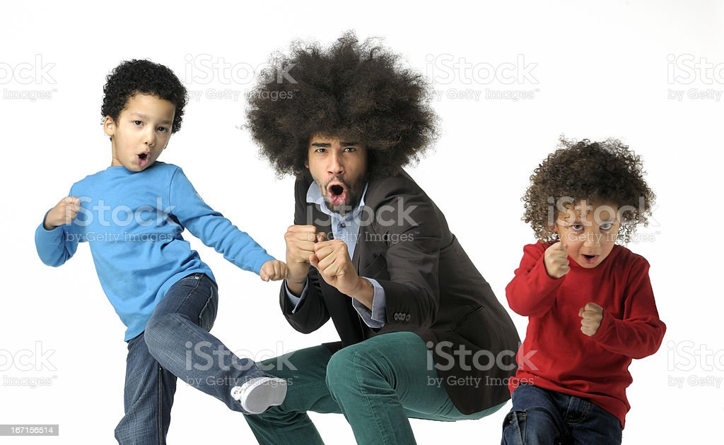 shadow boxing funky man and two little boys stock photo
