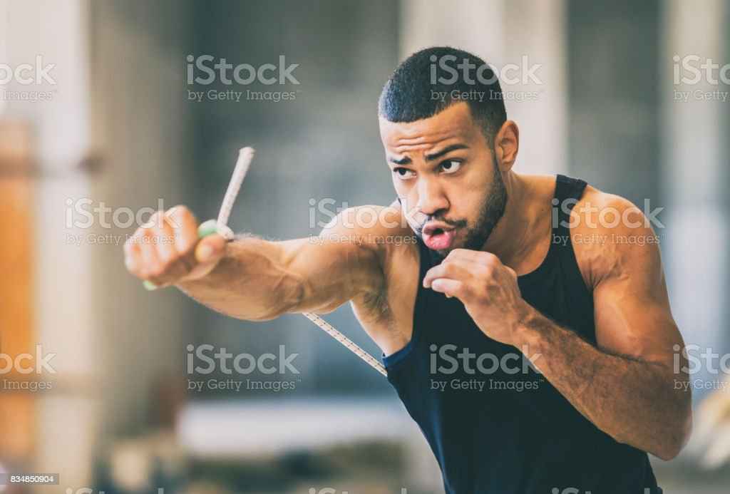 Shadow boxing in an urban gym stock photo
