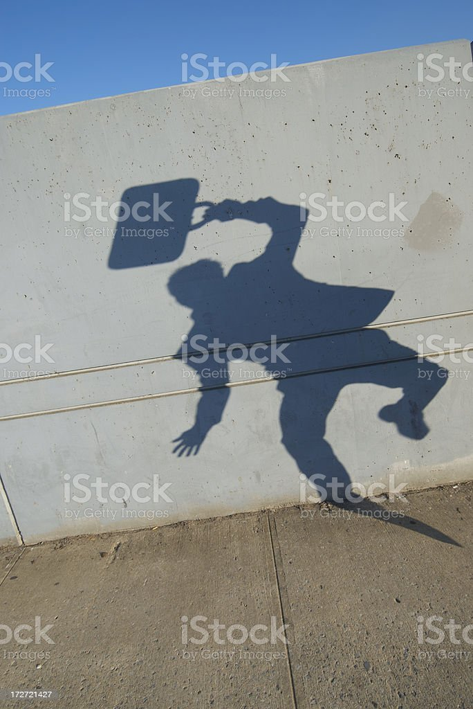 Shadow Businessman Jumps on Sidewalk royalty-free stock photo