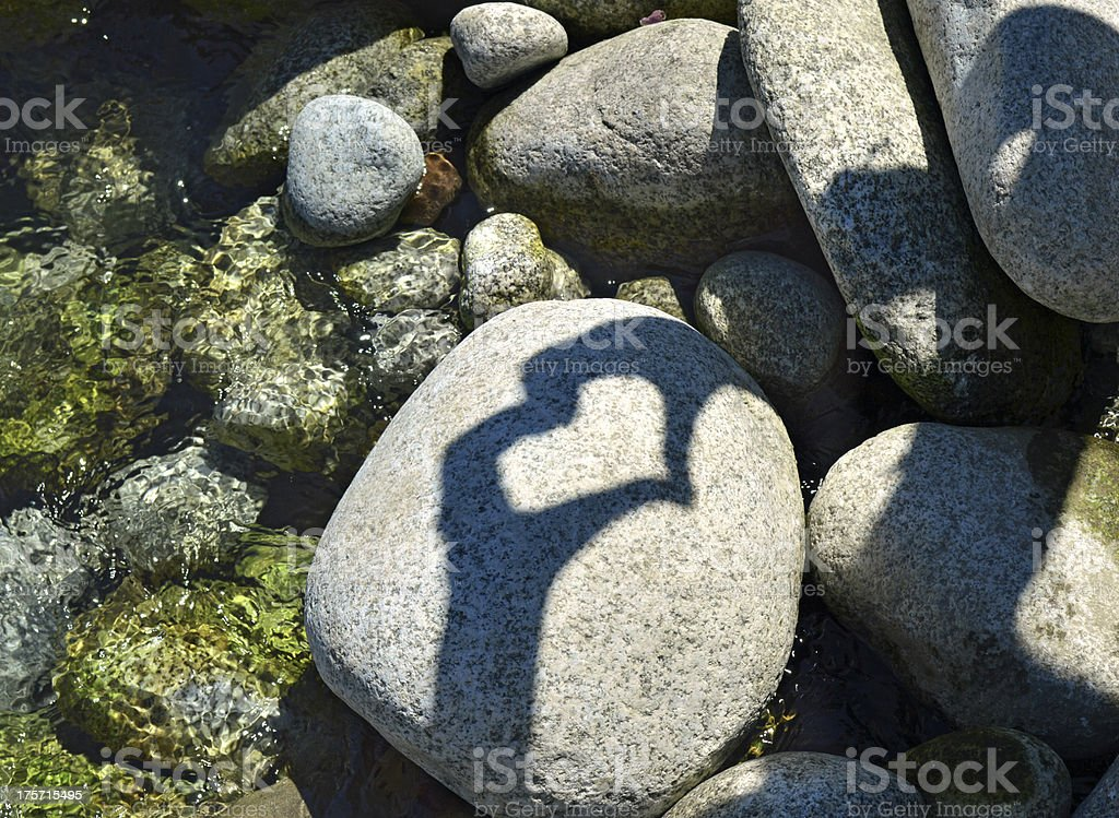 Shadow heart on the stone royalty-free stock photo