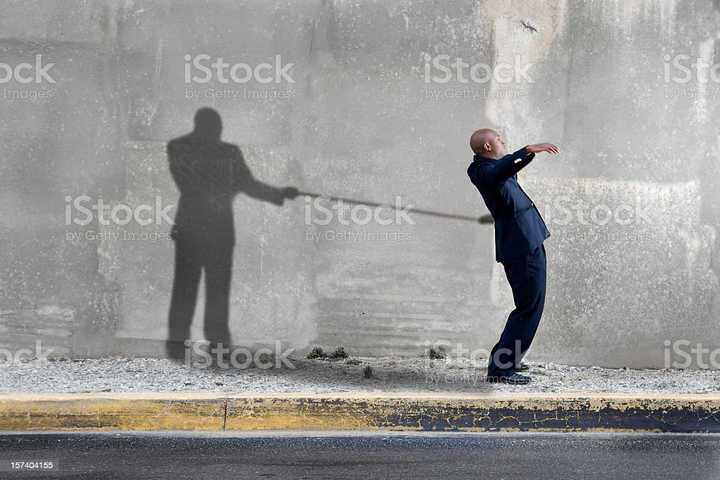 Shadow holding man back royalty-free stock photo