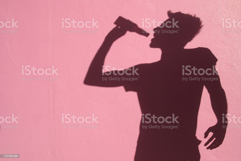 Shadow Man Swills From a Bottle royalty-free stock photo