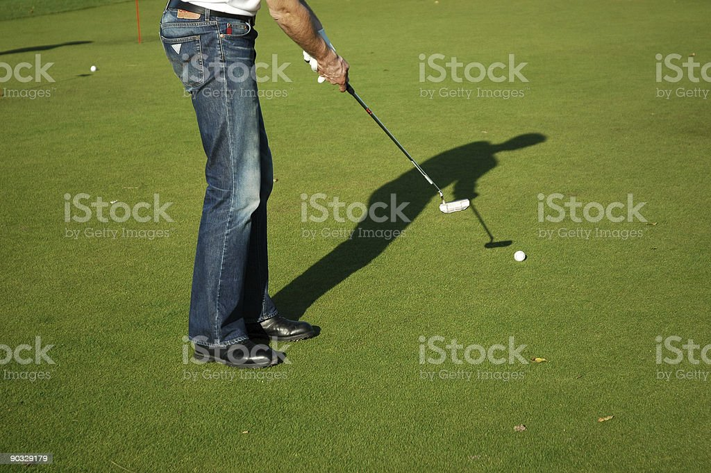 Shadow of a boy dressed casual putting on the green royalty-free stock photo