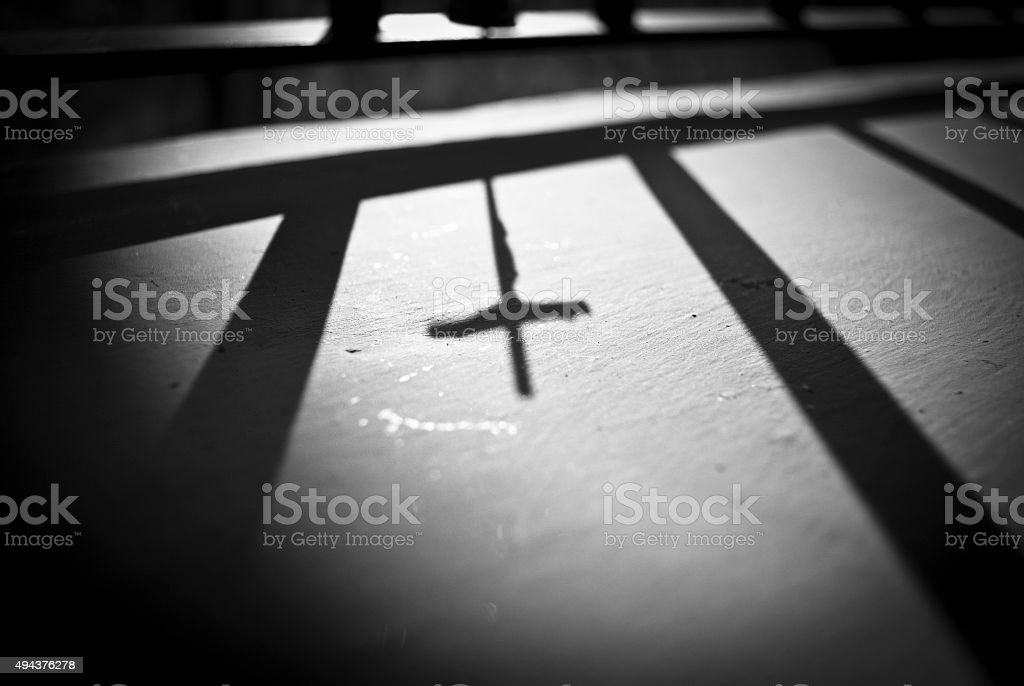 Shadow of a cross stock photo