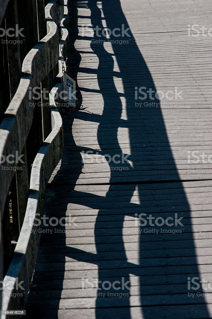 Shadow of a guard rail stock photo