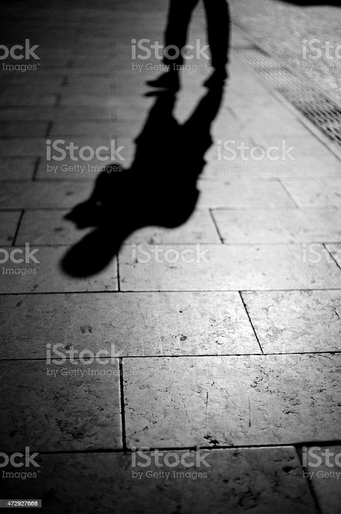 Shadow of a human figure stock photo