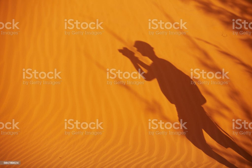 shadow of a man on the sand in Vietnam stock photo