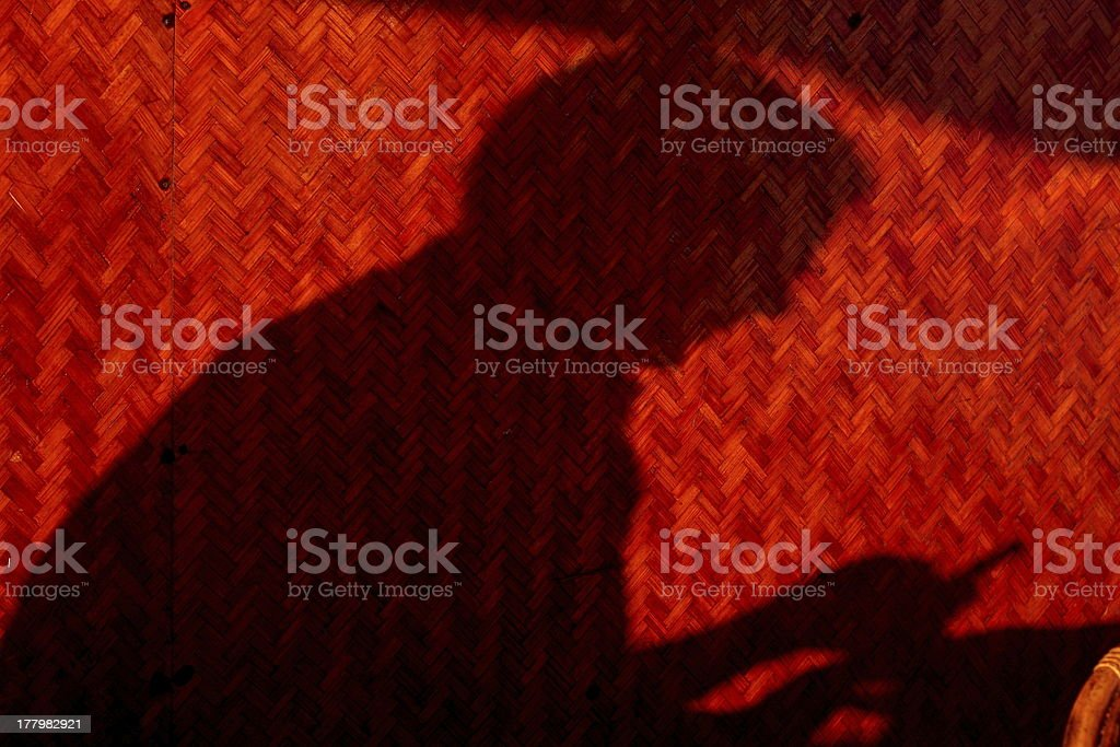 Shadow of a man texting on phone. stock photo