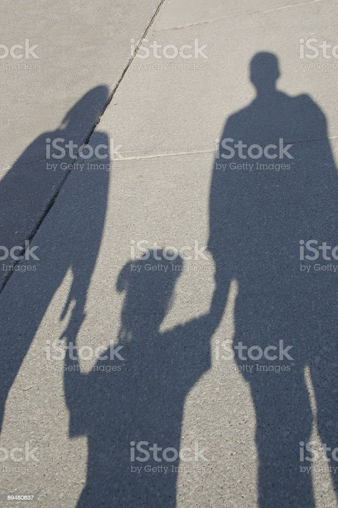 Shadow of a mother, father and toddler stock photo
