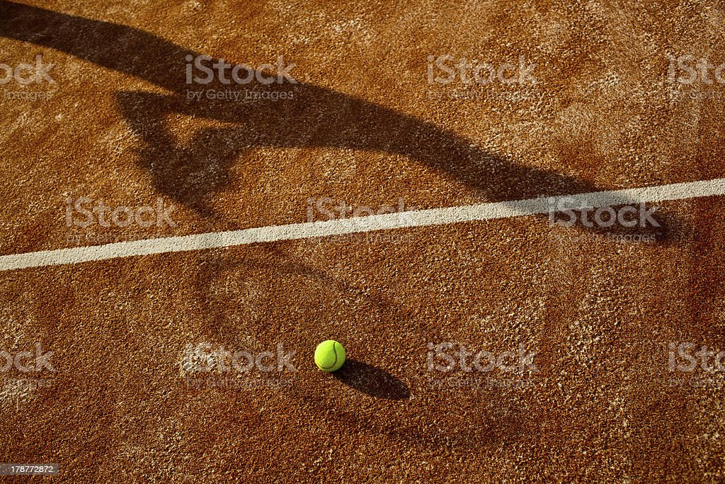shadow of a tennis player in action royalty-free stock photo