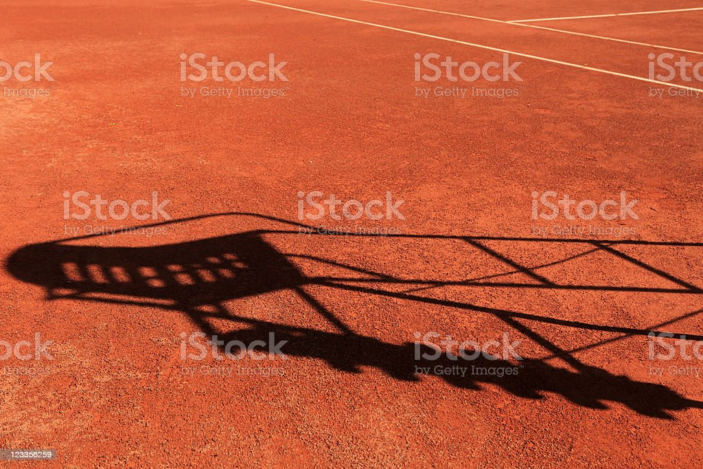 shadow of a tennis umpire's chair royalty-free stock photo