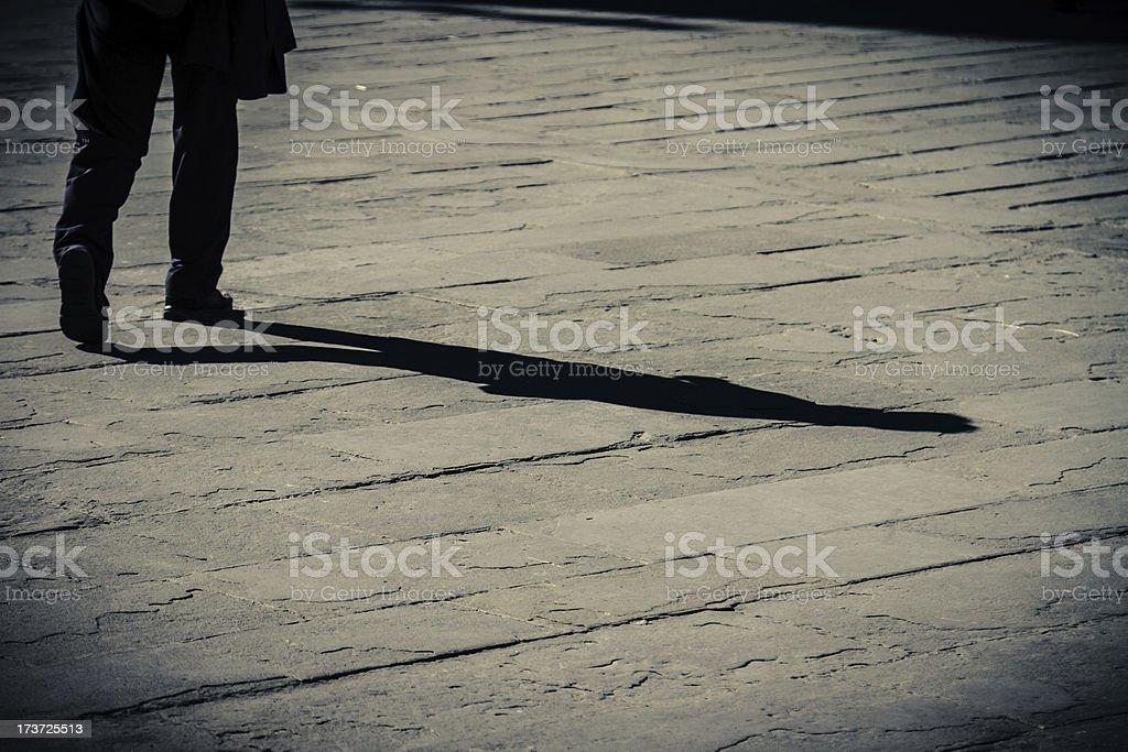 Shadow of a walking man royalty-free stock photo