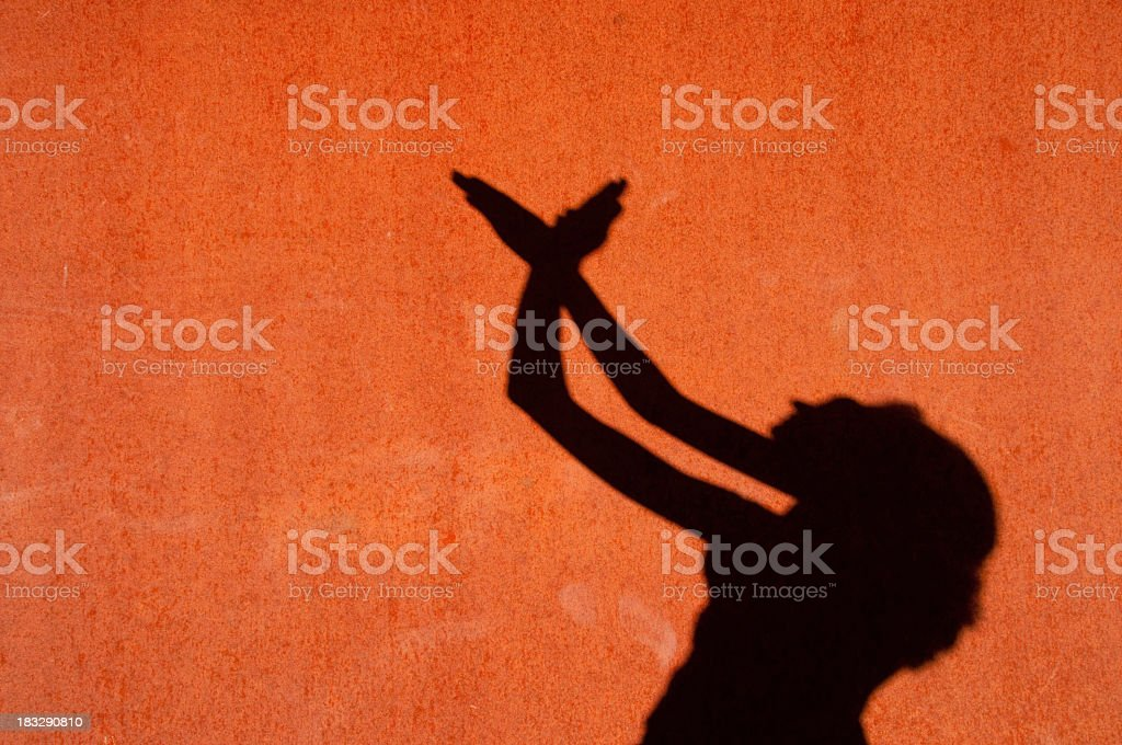 Shadow of a woman on rusted metal stock photo
