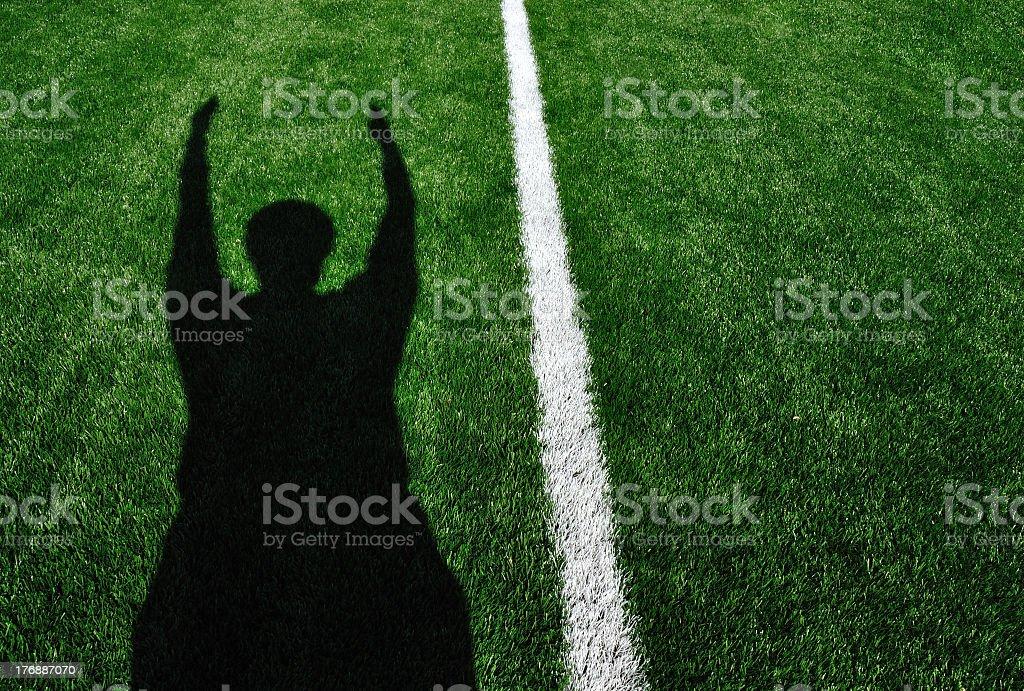 Shadow of American football referee on football field stock photo