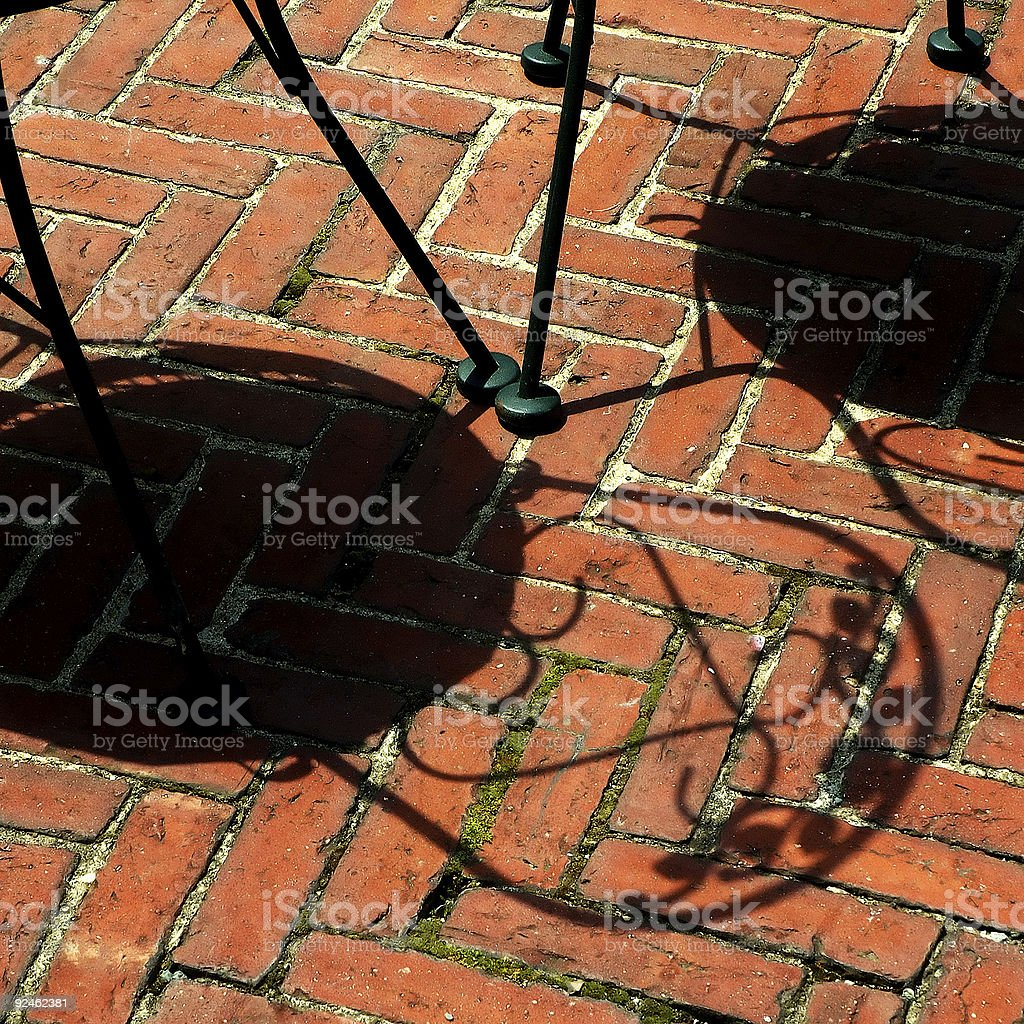 Shadow of ametal bisto chair royalty-free stock photo