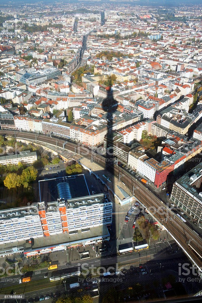 Shadow of Berlin TV tower on the city stock photo
