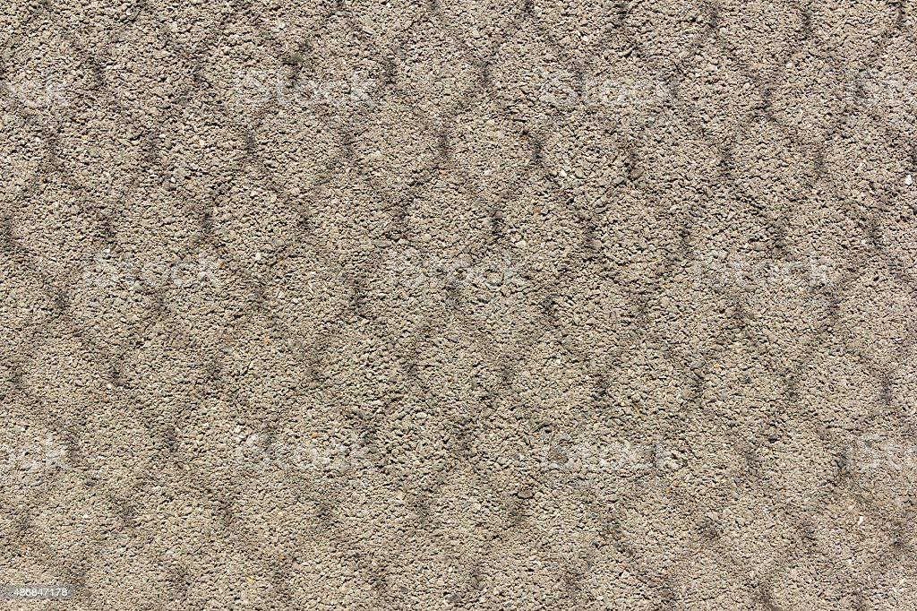 Shadow of chain link fence on floor stock photo