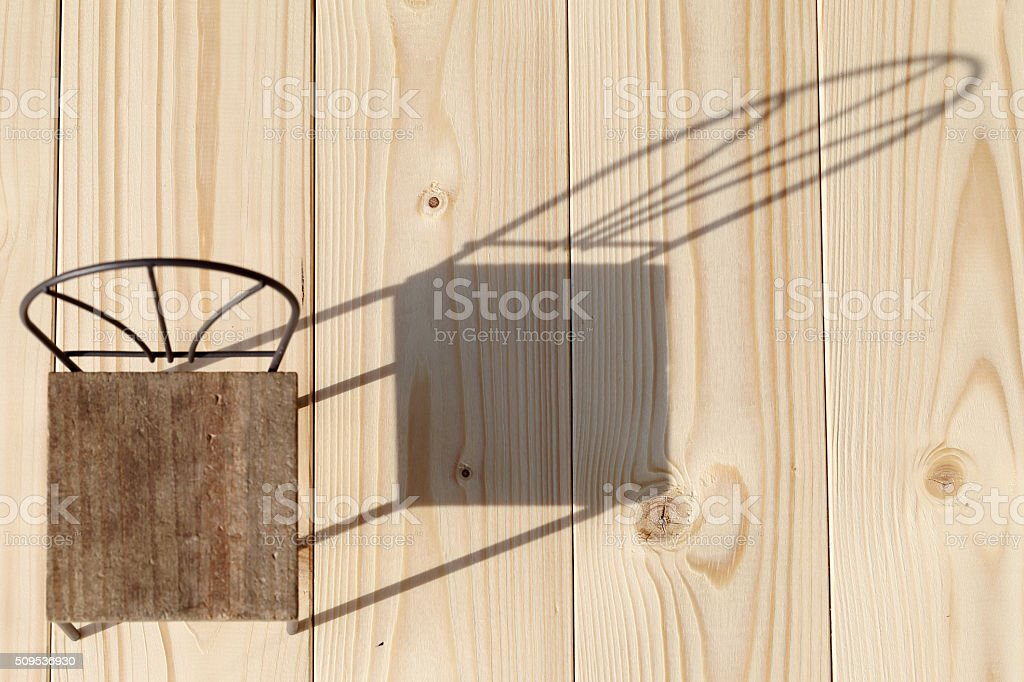shadow of chair on the wooden floor stock photo
