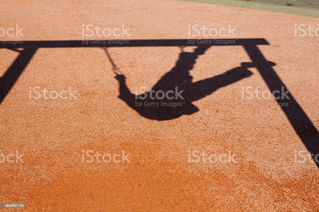 Shadow of child on  playground royalty-free stock photo