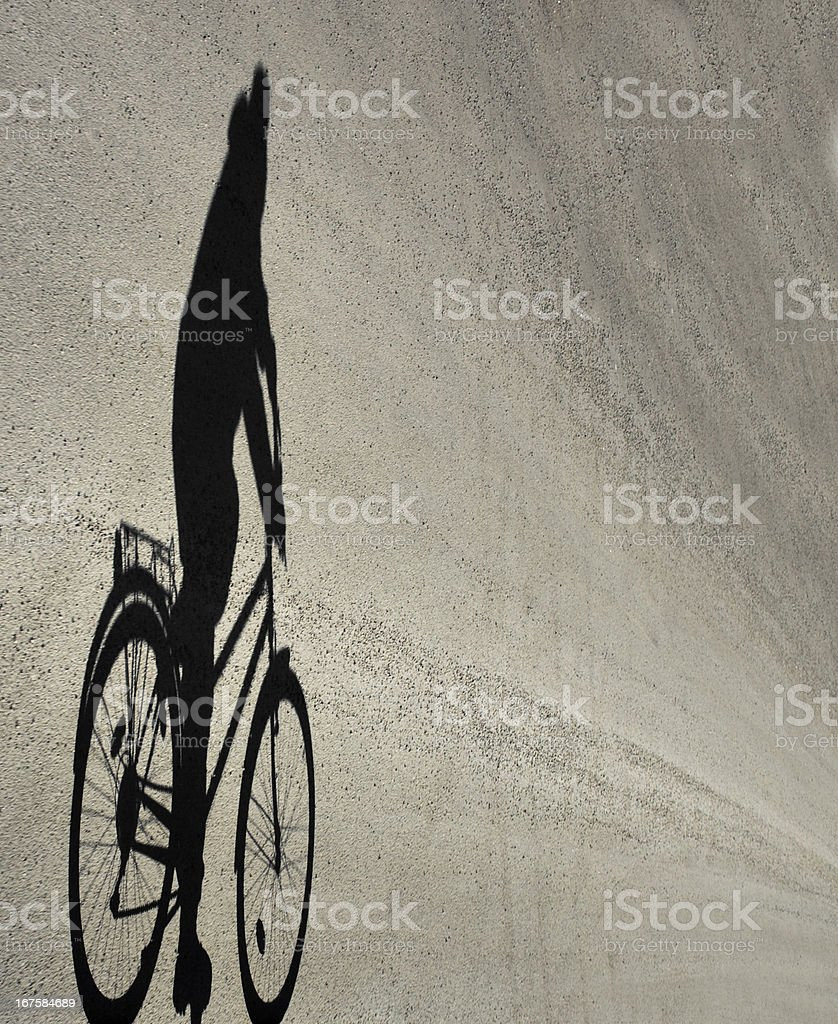Shadow of cyclist royalty-free stock photo