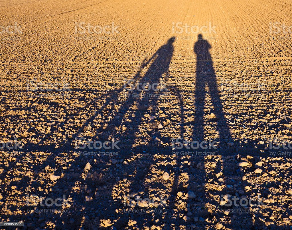 shadow of gesturing man stock photo