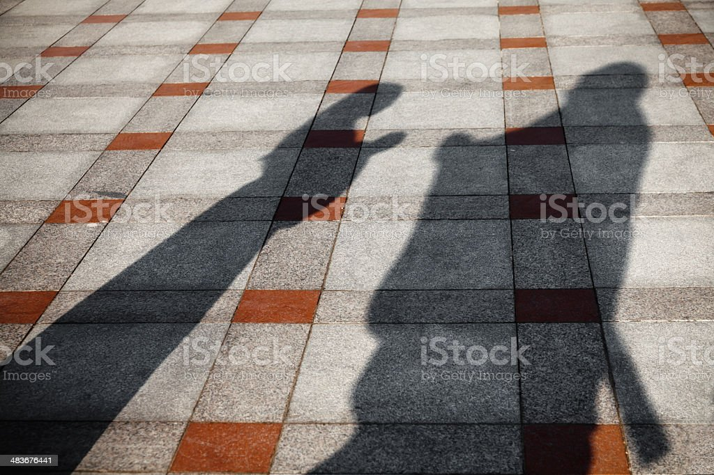 Shadow of girl bowed to Confucius stock photo