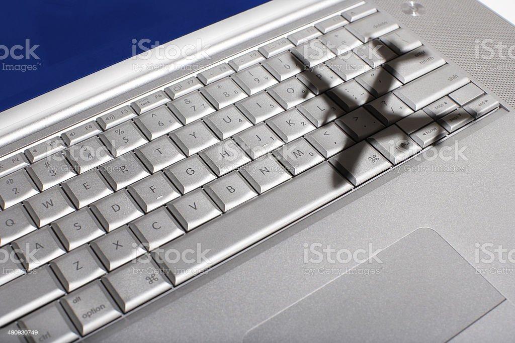 Shadow of jumbo jet over keyboard stock photo