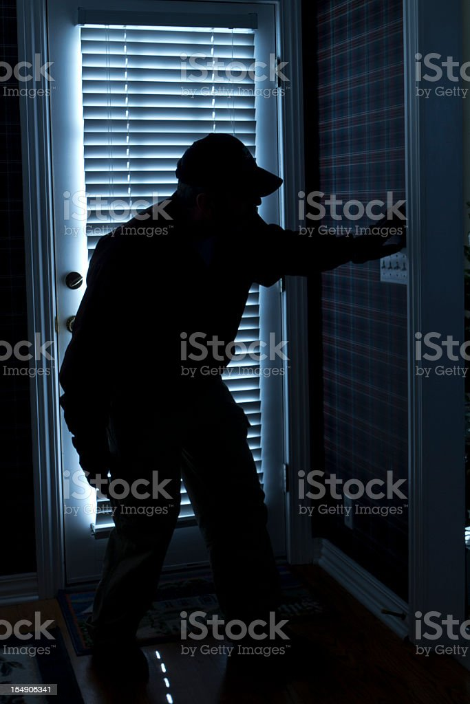 Shadow of man in the dark right next to the front door royalty-free stock photo